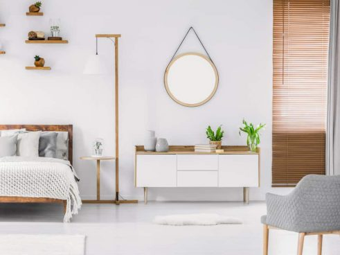 modern bedroom with ligth wood and plants